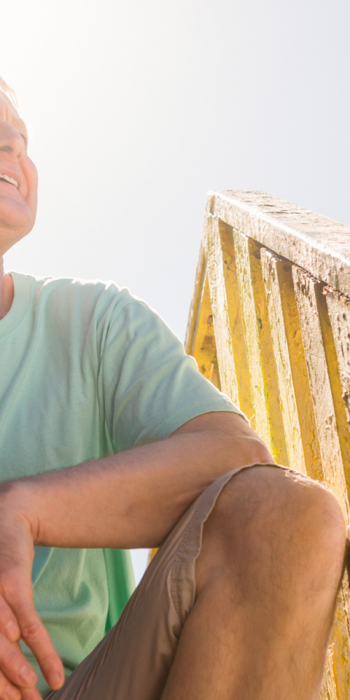Man enjoys life at his beach house after life changing Peripheral Neuropathy treatments